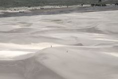Hikers on sand dunes Stock Photo