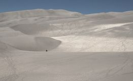 Hikers on sand dunes Stock Photography