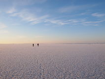 Hikers on a sea ice Stock Photo