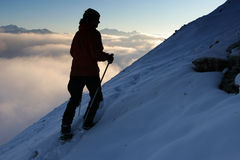 Hikers silhouette. Winter mountain trekking - silhouette of a climber Stock Images