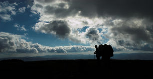 Hikers' silhouettes. On the top of the mountain, Ukrainian Carpathians royalty free stock images