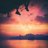 Hikers sit above the Crimea sea bay. Instagram stylization Stock Photo