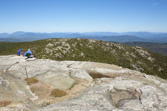 Hikers sitting on summit of Mt. Cardigan near Grafton, New Hamps Stock Images