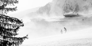 Snowstorm in the mountains at winter time. Mountains of Trentino Alto Adige, South Tyrol. Hikers ski in poor visibility due to a snowstorm in the South Tyrolean royalty free stock images