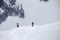 Hikers on the snow at the Aiguille du Midi mountain Royalty Free Stock Photography