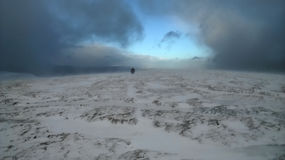 Hikers in Snowstorm, Brecon Beacons, Wales Stock Photo