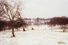 Hikers in a snowy field stock photography