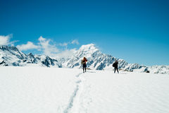Hikers on snowy mountain Stock Photography