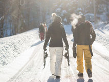 Hikers on snowy path Stock Images