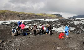 Hikers on Solheimajokull Glacier, Iceland. Hikers prepare to begin a guided hike on the Solheimajokull glacier in southern Iceland Stock Photography