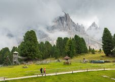 Hikers in South Tyrol / Alto Adige, Dolomites region of northern Italy during the summer.  royalty free stock photography