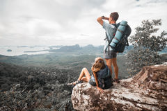 Hikers stand on top of a mountain Royalty Free Stock Image
