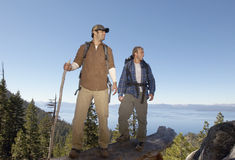 Hikers Standing On Log Near Forest Royalty Free Stock Photo