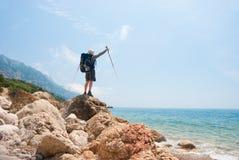 Hikers on a stony sea shore Royalty Free Stock Photo