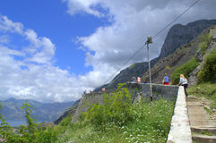 Hikers in summer mountain old fortification Stock Photo