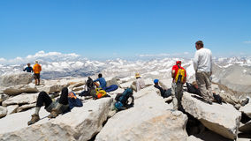 Hikers on the Summit of Mount Whitney. MOUNT WHITNEY, CA - JUNE 30: Hikers rest after a strenuous climb on June 30, 2010, on the summit of Mount Whitney. In 2009 Royalty Free Stock Image