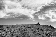 Hikers on the summit of Mt. Baldy near Los Angeles, black and white. Two hikers atop the tallest peak in Los Angeles County, 10,064 feet. The peak is also known Royalty Free Stock Image
