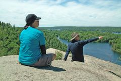 Rock Dunder Hiking Trail, Lyndhurst, Ontario, Canada. Hikers on the summit of the Rock Dunder Hiking Trail, above the Rideau Canal, Lyndhurst, Ontario, Canada, a stock image