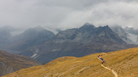Hikers in the Swiss Alps Stock Photos