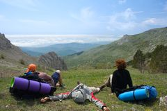 Hikers takes a rest on pass in mountains Royalty Free Stock Photography