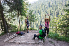 Hikers taking a break on a mountain peak Stock Photography