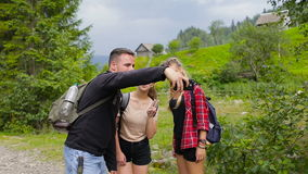 Hikers taking selfies in the mountains on the road stock video footage
