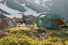 Hikers with tent. Royalty Free Stock Images