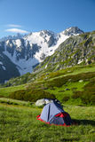Hikers tent in mountans Stock Photo