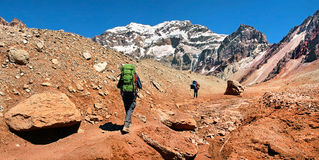 Hikers on their way to Aconcagua as seen in the background, Argentina, South America. Hikers on their way to Aconcagua as seen in the background, Aconcagua royalty free stock images