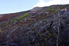 Hikers on their way to the peak of Fujisan, Mount Fuji, Japan stock photos