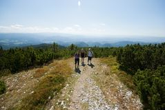 Hikers on the top of mountains Royalty Free Stock Images