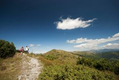 Hikers on the top of mountains Stock Photos