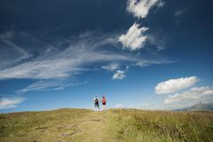 Hikers on the top of mountains Stock Photo