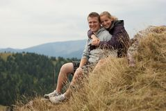 Hikers on the top of mountains Stock Images