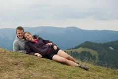 Hikers on the top of mountains Stock Image