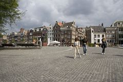 Hikers on the Torensluis on the Singel in Amsterdam Stock Photos