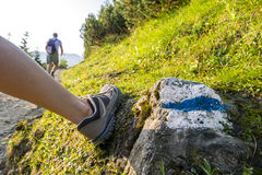 Hikers on a trail in beautiful mountains Stock Photo