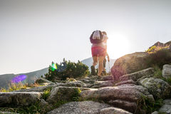Hikers on a trail in beautiful mountains Stock Photos