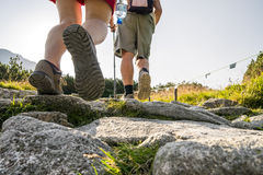 Hikers on a trail in beautiful mountains Stock Image
