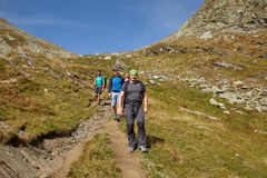 Hikers on a trail Royalty Free Stock Image
