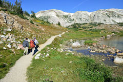 Hikers on a trail in Medicine Bow Mountains of Wyoming. During summer royalty free stock images