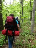 Hikers on the trail in nature hiking backpacking. In southern illinois Royalty Free Stock Photo