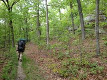 Hikers on the trail in nature hiking backpacking. In southern illinois Stock Photo
