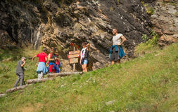 Hikers on the trail to the top of the mountain. Rabbi Valley, Trentino Alto Adige, Italy Royalty Free Stock Photo