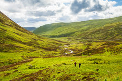Hikers on trails Highlands Scotland Royalty Free Stock Photography