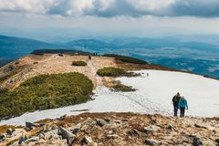 Hikers travel in the Babia Gora Mountain with a backpack. Zawoja, Poland - May 03, 2015: Hikers travel in the Babia Gora Mountain with a backpack Royalty Free Stock Photos