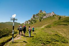 Hikers traveling in the Ciucas Mountains, Romania. Group of hikers traveling in the Ciucas Mountains, part of the wild Carpathian range that crosses Romania Royalty Free Stock Photography