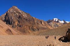 Hikers trekking in the Andes, South America. Hikers trekking in the Andes near Aconcagua, Mendoza, Argentina, South America stock photography