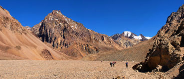 Hikers trekking in the Andes, South America. Hikers trekking in the Andes near Aconcagua, Mendoza, Argentina, South America stock photos