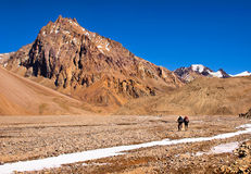 Hikers trekking in the Andes, South America Stock Photo